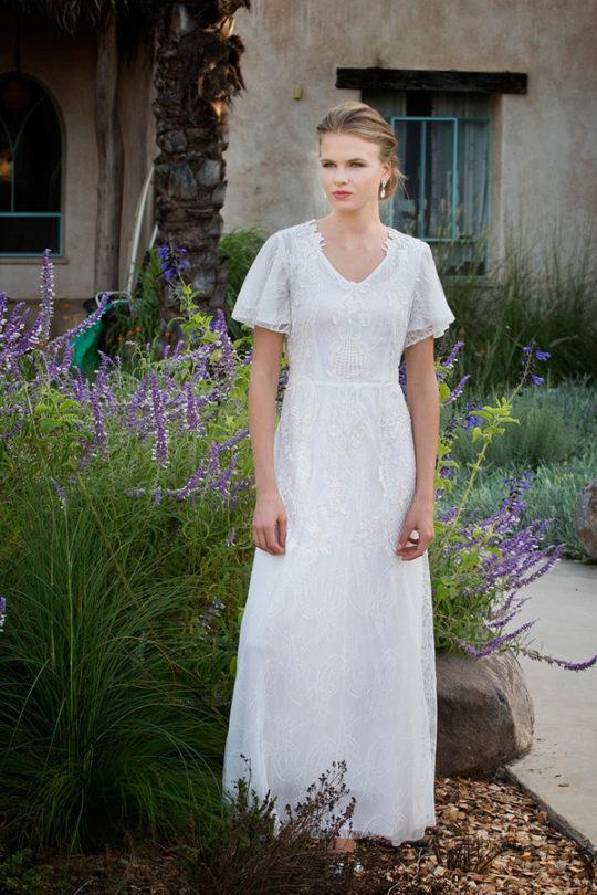 שמלת כלה בעלת שרוולי פעמון